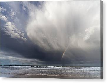 A Rainbow In The Dark Clouds Canvas Print by John Short