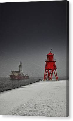 A Red Lighthouse Along The Coast In Canvas Print by John Short