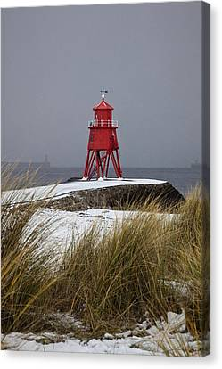A Red Lighthouse Along The Coast South Canvas Print by John Short