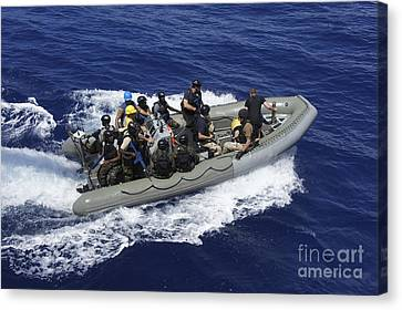 A Rigid-hull Inflatable Boat Carrying Canvas Print