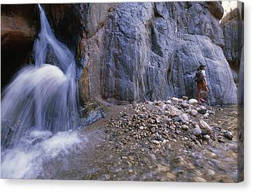 A River Guide Escapes The Heat Next Canvas Print by Bill Hatcher