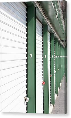 A Row Of Locked Storage Units At A Self Storage Facility Canvas Print by Frederick Bass