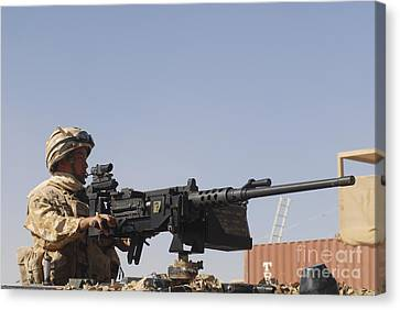 A Royal Marine Manning A .50 Caliber Canvas Print by Andrew Chittock