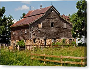 A Rustic Barn Canvas Print by Wayne Stabnaw
