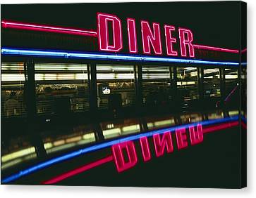 A Sign Relects Off A Car Roof Canvas Print by Stephen St. John