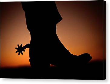 Santa Fe Cowgirl Canvas Print - A Silhouette Of A Boot And Spur With An by Todd Gipstein