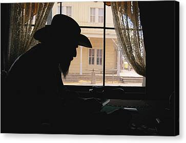 Santa Fe Cowgirl Canvas Print - A Silhouetted Cowboy Gambles In This by Stephen St. John