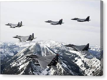A Six-ship Formation Of Aircraft Fly Canvas Print by Stocktrek Images