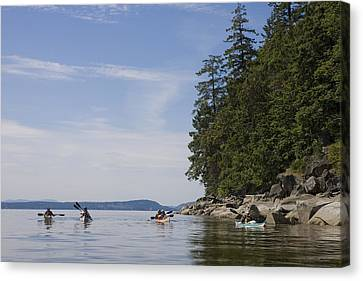 A Small Group Of People Kayak Canvas Print by Taylor S. Kennedy