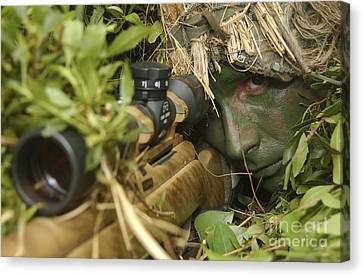 A Sniper Dressed In A Ghillie Suit Canvas Print by Stocktrek Images