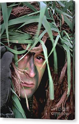 A Soldier Camouflaged In His Ghillie Canvas Print by Stocktrek Images