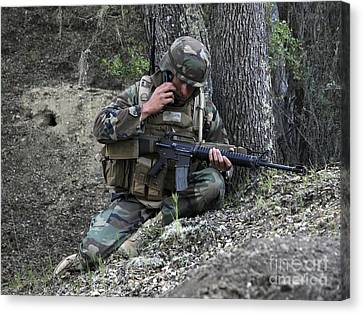 A Soldier Communicates His Position Canvas Print by Stocktrek Images