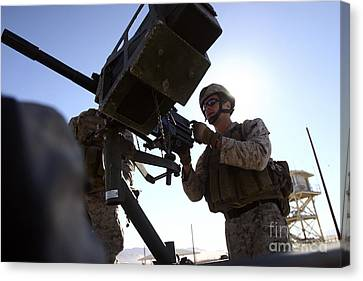 A Soldier Fires 40mm Rounds Canvas Print by Stocktrek Images