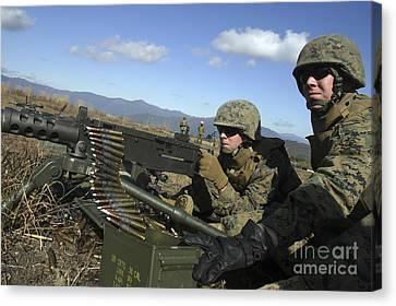 A Soldier Fires An M2 .50 Caliber Canvas Print