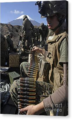 A Soldier Links .50 Caliber Rounds Canvas Print