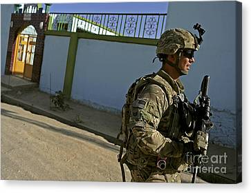 A Soldier Patrols The Streets Of Qalat Canvas Print by Stocktrek Images