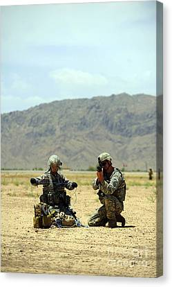 A Soldier Prepares A Drag Line While An Canvas Print by Stocktrek Images