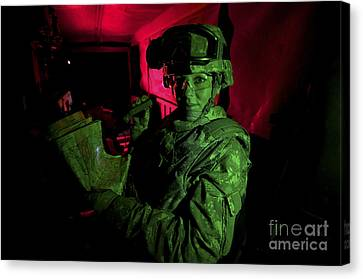 A Soldier Reads A Map At Night Canvas Print