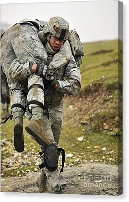 A Soldier Transports A Fellow Wounded Canvas Print by Stocktrek Images