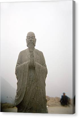 A Statue Of A Buddhist Monk In China Canvas Print by Justin Guariglia