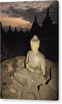 A Statue Of Buddha,  Borobudur, Java Canvas Print by Paul Chesley