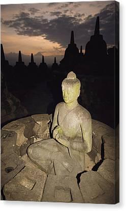 A Statue Of Buddha,  Borobudur, Java Canvas Print by Paul Chesley