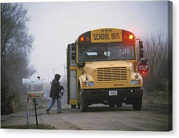 A Student Boards A School Bus Canvas Print by Joel Sartore