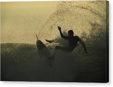 A Surfer Wipes Out On A Breaking Wave Canvas Print by Tim Laman