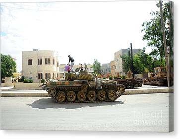 A T-72 Main Battle Tank On The Streets Canvas Print by Andrew Chittock