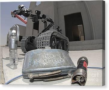 A Talon 3b Robot Recovering A Stick Canvas Print by Stocktrek Images