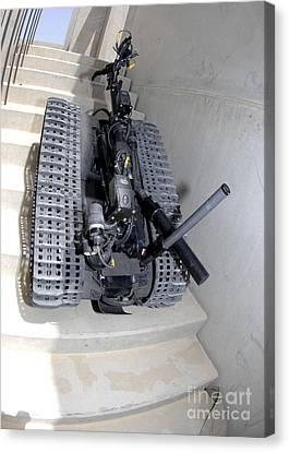 A Talon 3b Robot Unit Climbing A Flight Canvas Print by Stocktrek Images