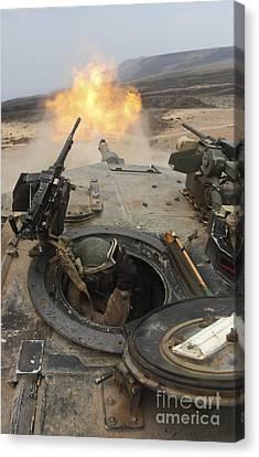A Tank Crewman Braces Himself Canvas Print by Stocktrek Images