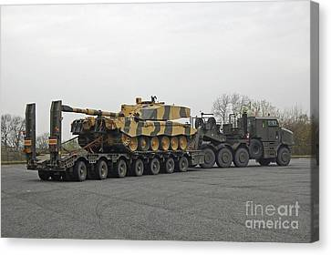 A Tank Transporter Hauling A Challenger Canvas Print by Andrew Chittock