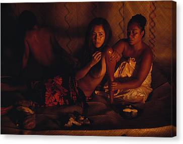 A Topless Tahitian Dancer Is Annointed Canvas Print by Gordon Gahan