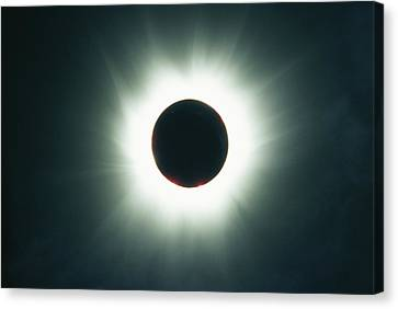 A Total Solar Eclipse Over France Canvas Print by Carsten Peter