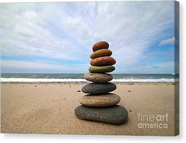 A Tower Of Stones On The Beach Canvas Print by Holger Ostwald