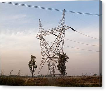 A Transmission Tower Carrying Electric Lines In The Countryside Canvas Print by Ashish Agarwal