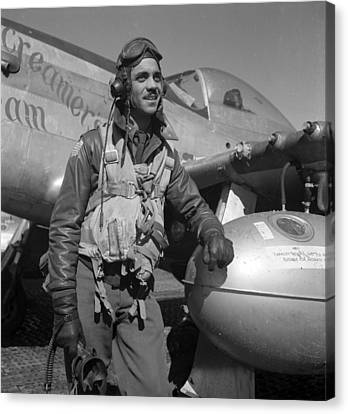 A Tuskegee Fighter Pilot Poses Canvas Print by Everett