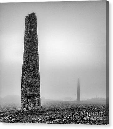 A Twin Cornish Mine Chimneys Canvas Print by John Farnan