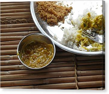 A Typical Plate Of Indian Rajasthani Food On A Bamboo Table Canvas Print by Ashish Agarwal
