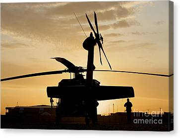 A Uh-60l Black Hawk Helicopter Canvas Print by Terry Moore