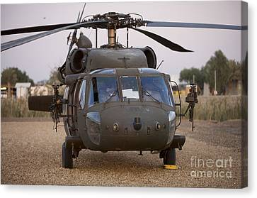 A Uh-60l Black Hawk With Twin M240g Canvas Print by Terry Moore