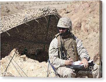 A U.s. Marine Communicates With Close Canvas Print by Stocktrek Images