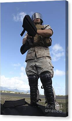 A U.s. Marine Dons Riot Gear For Drills Canvas Print by Stocktrek Images