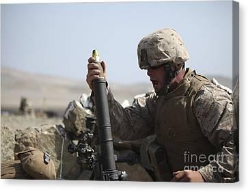 A U.s. Marine Loads A Mortar Canvas Print by Stocktrek Images
