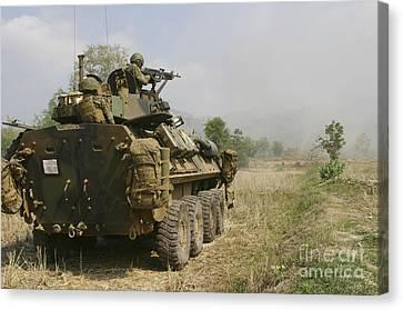 A U.s. Marine Uses An M-240b Machine Canvas Print by Stocktrek Images