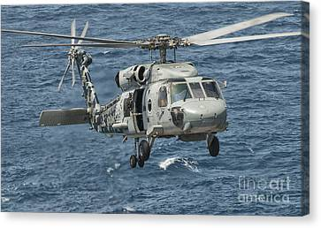 A Us Navy Sh-60f Seahawk Flying Canvas Print by Giovanni Colla