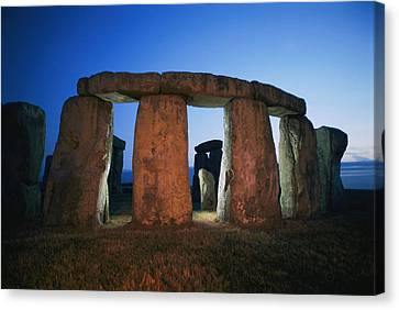 A View Of Stonehenge Silhouetted Canvas Print by Richard Nowitz