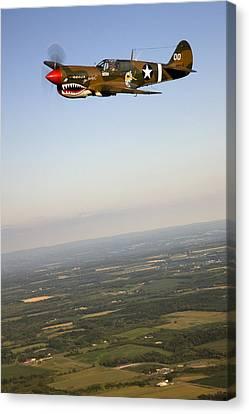 A Vintage World War II P-40n Fighter Canvas Print by Pete Ryan
