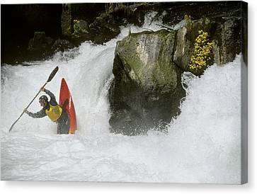 A Whitewater Kayaker Plays At The Base Canvas Print